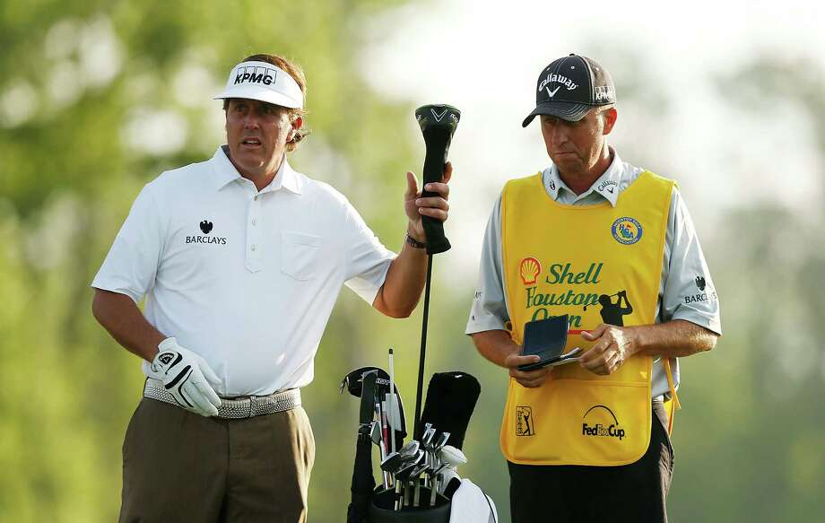 HUMBLE, TX - MARCH 30:  Phil Mickelson pulls a club as his caddie Jim Mackay looks on during the third round of the Shell Houston Open at the Redstone Golf Club on March 30, 2013 in Humble, Texas. Photo: Scott Halleran, Getty Images / 2013 Getty Images