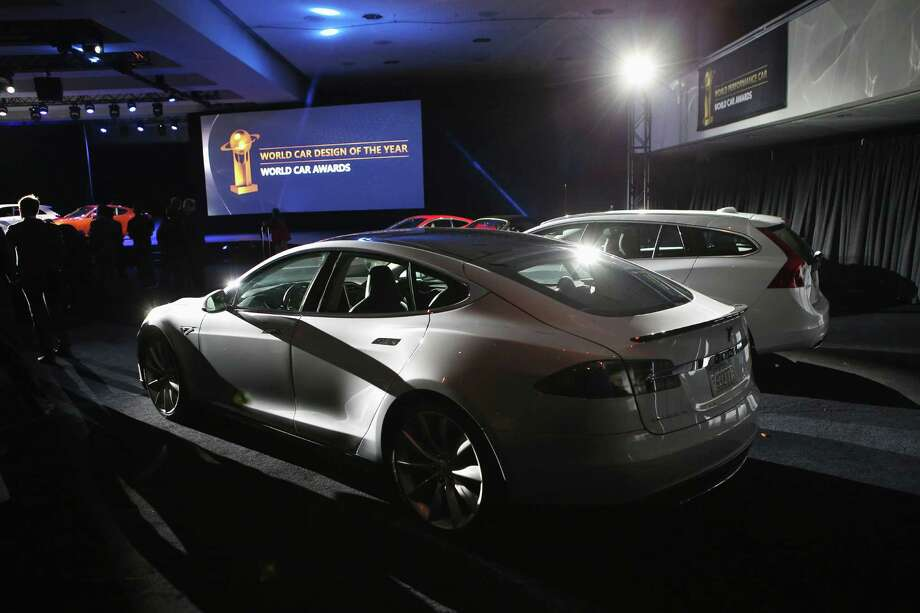 A Tesla Model S is displayed after winning the 2013 World Green Car of the Year. Photo: John Moore, Getty Images / 2013 Getty Images