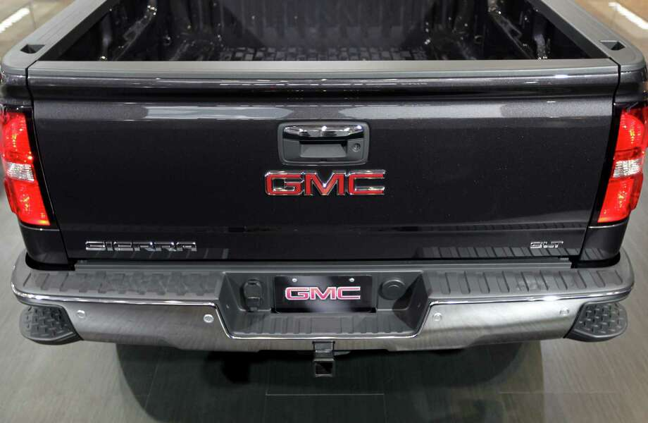 The rear of a General Motors Co. 2014 GMC Sierra is seen while on display at the company's booth. Photo: Jin Lee, Bloomberg / © 2013 Bloomberg Finance LP
