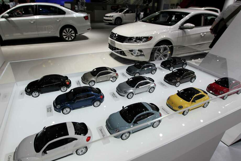 Miniature Volkswagen AG cars are displayed at the company's booth. Photo: Jin Lee, Bloomberg / © 2013 Bloomberg Finance LP