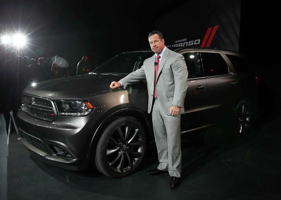 Reid Bigland, chief executive officer of Chrysler Canada Inc., stands for a photograph in front of the Dodge Durango. Photo: Jin Lee, Bloomberg / © 2013 Bloomberg Finance LP