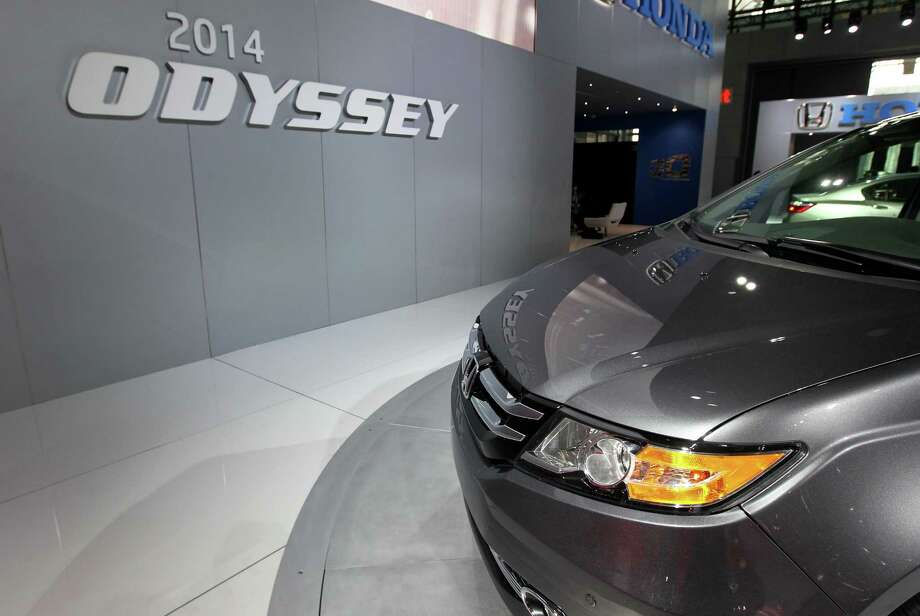 The Honda 2014 Odyssey minivan sits on display. Photo: Jin Lee, Bloomberg / © 2013 Bloomberg Finance LP