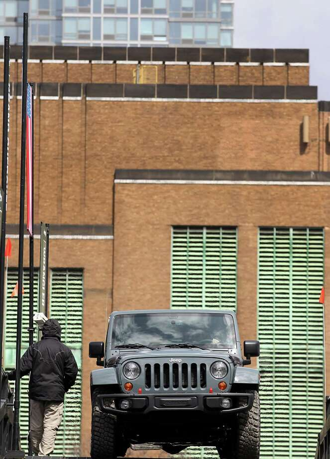 The Chrysler Group LLC Jeep Rubicon vehicle drives through the company's trail ride set up at the 2013 New York International Auto Show in New York, U.S., on Thursday, March 28, 2013. The 113th New York International Auto Show, which runs from March 29 to April 7, features 1,000 vehicles as well the latest in tech, safety and innovation. Photographer: Jin Lee/Bloomberg Photo: Jin Lee, Bloomberg / © 2013 Bloomberg Finance LP