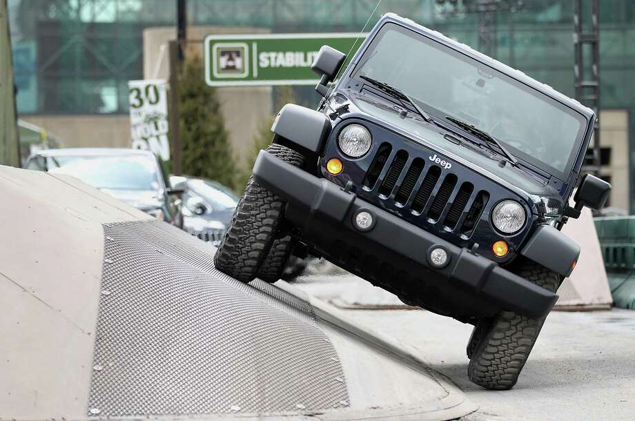 The Chrysler Jeep Rubicon vehicle drives through the company's trail ride. Photo: Jin Lee, Bloomberg / © 2013 Bloomberg Finance LP