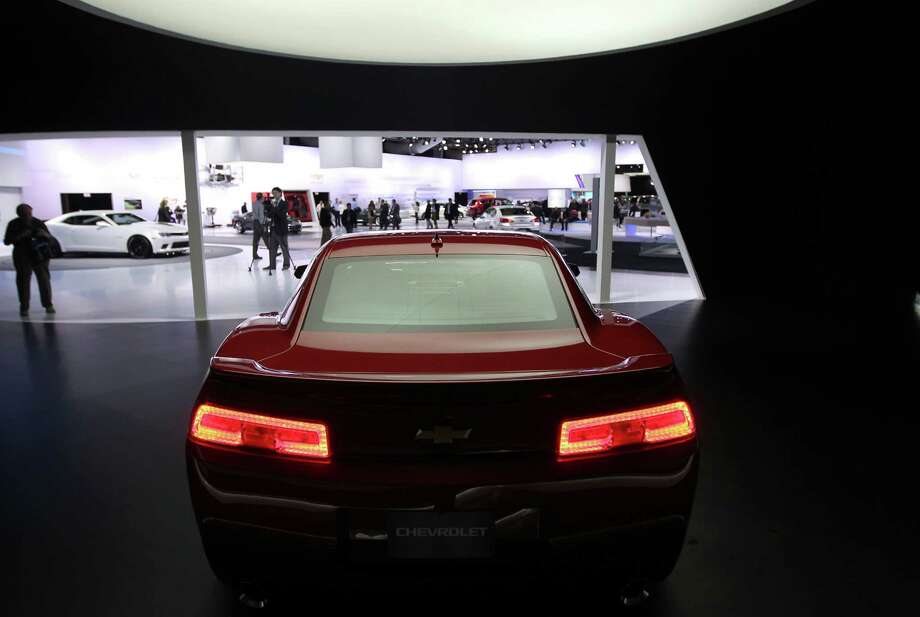 The Chevrolet 2014 Camaro vehicle sits on display at the company's booth during the 2013 New York International Auto Show in New York, U.S., on Thursday, March 28, 2013. The 113th New York International Auto Show, which runs from March 29 to April 7, features 1,000 vehicles as well the latest in tech, safety and innovation. Photographer: Jin Lee/Bloomberg Photo: Jin Lee, Bloomberg / © 2013 Bloomberg Finance LP