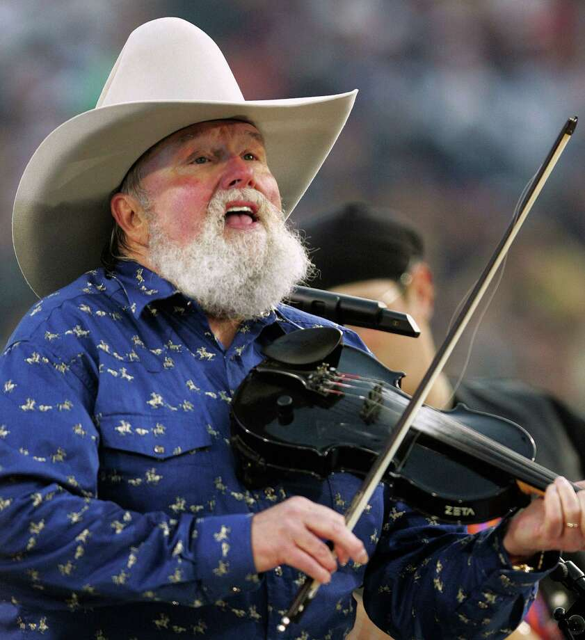 FILE - In this Feb. 6, 2005 file photo, Charlie Daniels performs during pre-game festivities before Super Bowl XXXIX between the New England Patriots and the Philadelphia Eagles at Alltel Stadium in Jacksonville, Fla. A representative for Charlie Daniels says the 76-year-old country singer is recovering after having a pacemaker implanted Thursday, March 28, 2013. (AP Photo/David J. Phillip, File) Photo: DAVID J. PHILLIP
