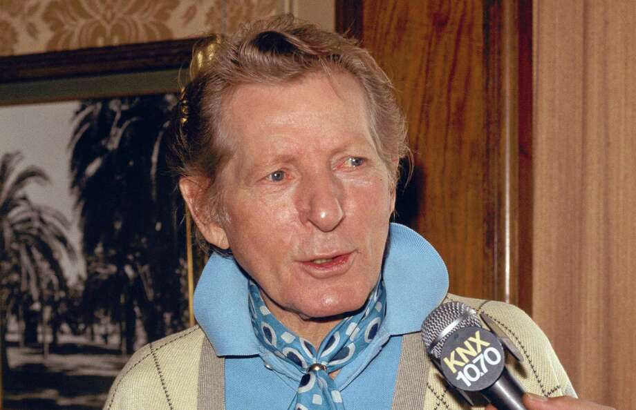 FILE - In this Sept. 27, 1983 file photo, entertainer Danny Kaye is interviewed by the media in Pasadena, Calif.  In the 100th year of his birth, Dena Kaye is determined to help a new generation discover the genius, and the generosity, of her father, who died in 1987 at age 74.  Danny Kaye is now on Facebook with an official page. His official Website has been relaunched with plenty of multimedia. The Library of Congress unveiled its new Danny and Sylvia Fine Archive, where countless documents, including video, audio and photographs from Dena's parents' own collection, are available for examination on the Internet. (AP Photo/Wally Fong) Photo: WALLY FONG