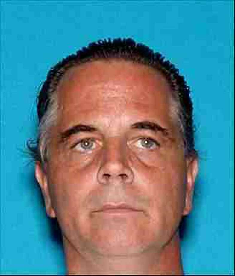 This image provided by the Siskiyou County Sheriff's office shows David Dean Johnson, who is suspected of stealing more than $1 million in gold from the Siskiyou County's historic collection early last year. Officials say Johnson and Scott Wayne Bailey broke into the gold collection at the Siskiyou County Courthouse in Yreka in February 2012 and made off with $1,257,500 in gold, jewelry and artifacts. (AP Photo/Siskiyou County Sheriff) Photo: Uncredited, Associated Press