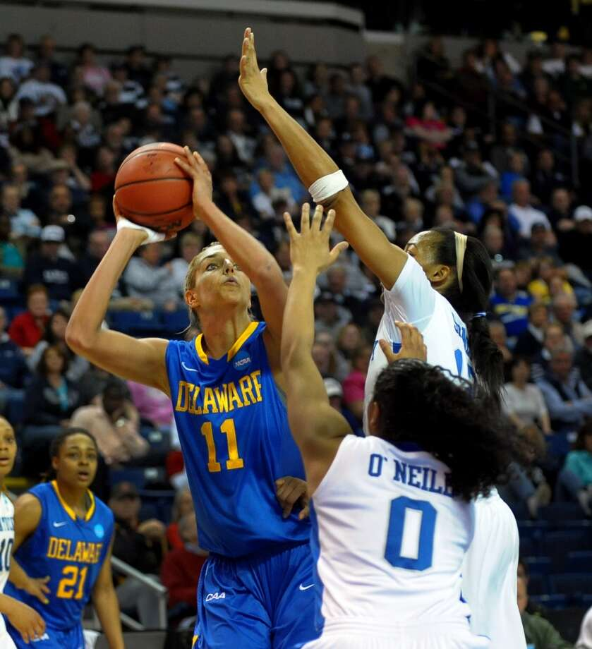 University of Delaware's Elena Delle Donne attempts a basket as she is blocked by University of Kentucky's Jelleah Sidney, during the women's NCAA Tournament Regional Semifinals at the Webster Bank Arena in Bridgeport, Conn. on Saturday March 30, 2013.