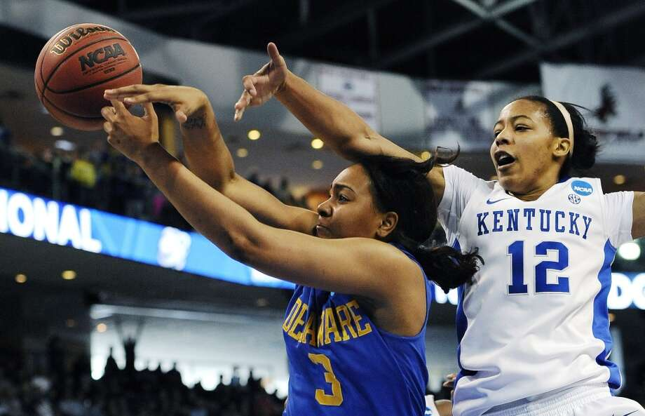 Delaware guard Jaquetta May (3) tries to grab a rebound against Kentucky's Jelleah Sidney (12) during the first half of a regional semifinal in the women's NCAA college basketball tournament in Bridgeport, Conn., Saturday, March 30, 2013. (AP Photo/Jessica Hill)