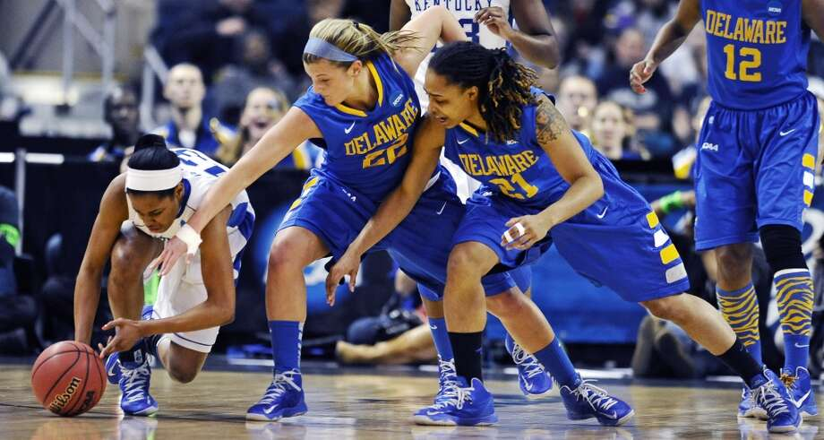 Kentucky guard Bria Goss, left, grabs a loose ball against Delaware guards Lauren Carra (22) and Trumae Lucas (21) during the first half of a regional semifinal in the women's NCAA college basketball tournament in Bridgeport, Conn., Saturday, March 30, 2013. (AP Photo/Jessica Hill)