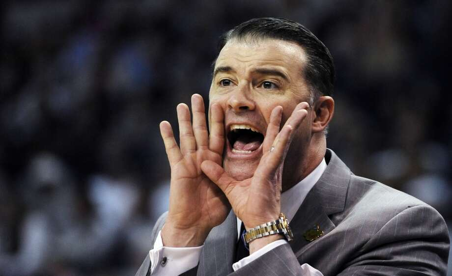 Kentucky head coach Matthew Mitchell calls to his players during the first half of a regional semifinal in the women's NCAA college basketball tournament against Delaware in Bridgeport, Conn., Saturday, March 30, 2013. (AP Photo/Jessica Hill)