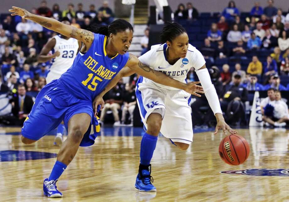 Delaware guard Akeema Richards (15) reaches on a steal attempt against Kentucky guard A'dia Mathies, right, during the first half of a regional semifinal in the women's NCAA college basketball tournament in Bridgeport, Conn., Saturday, March 30, 2013. (AP Photo/Charles Krupa)