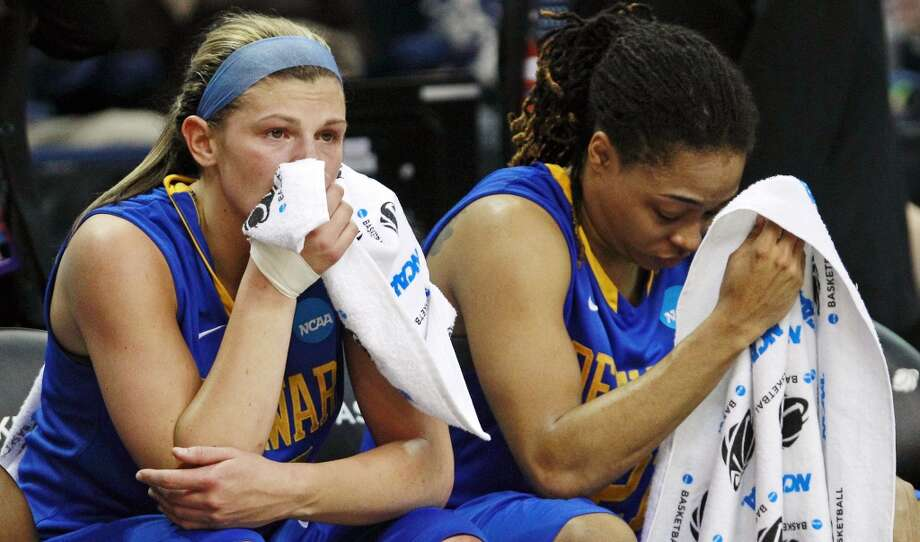 Delaware guards Lauren Carra, left, and Trumae Lucas sit on the bench during the final minute of a regional semifinal in the NCAA college basketball tournament against Kentucky in Bridgeport, Conn., Saturday, March 30, 2013. Kentucky won 69-62. (AP Photo/Charles Krupa)