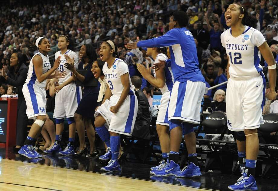 The Kentucky bench, including Azia Bishop (50), Janee Thompson (3) and Jelleah Sidney (12), celebrates during the final seconds of a regional semifinal against Delaware in the NCAA college basketball tournament in Bridgeport, Conn., Saturday, March 30, 2013. Kentucky won 69-62. (AP Photo/Jessica Hill)