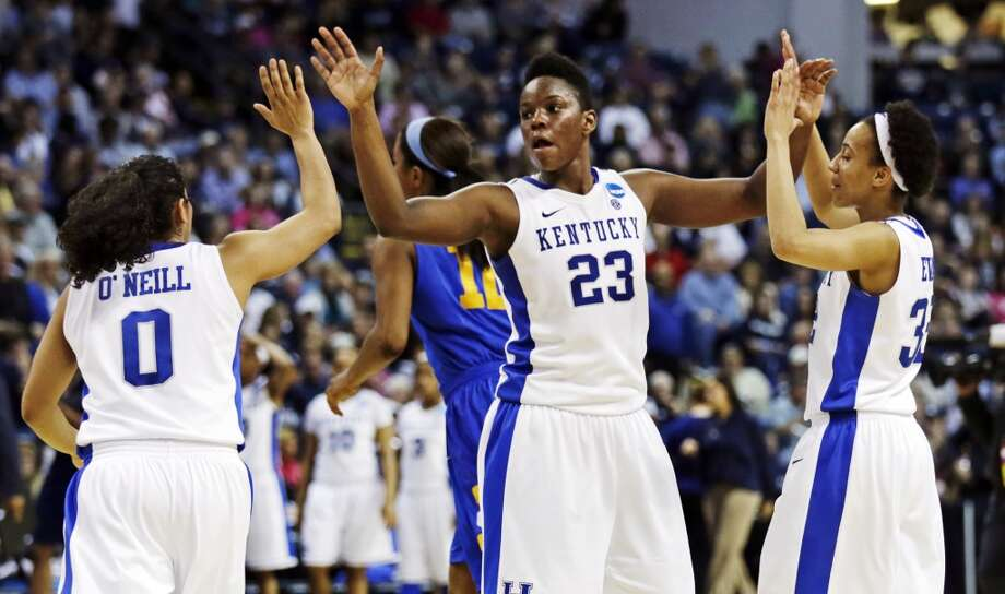 Kentucky forward Samarie Walker (23) congratulates guards Jennifer O'Neill (0) and Kastine Evans, right, after defeating Delaware 69-62 in a regional semifinal in the NCAA college basketball tournament in Bridgeport, Conn., Saturday, March 30, 2013. (AP Photo/Charles Krupa)