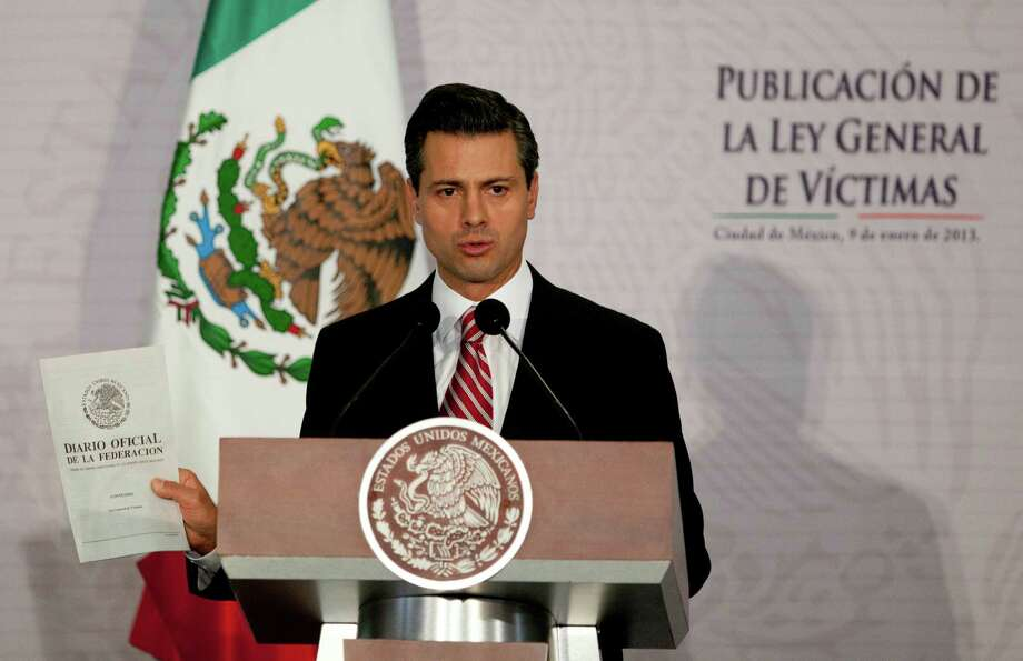 Mexico's President Enrique Pena Nieto delivers a speech during an event to enact a general law on victims of crime at Los Pinos presidential residence in Mexico City, Wednesday, Jan. 9, 2013. The law requires local and federal authorities to compensate victims by covering their health and psychiatric care costs and it mandates the creation of a relief fund and a national registry of victims of crime. (AP Photo/Eduardo Verdugo) Photo: Eduardo Verdugo, STF / AP
