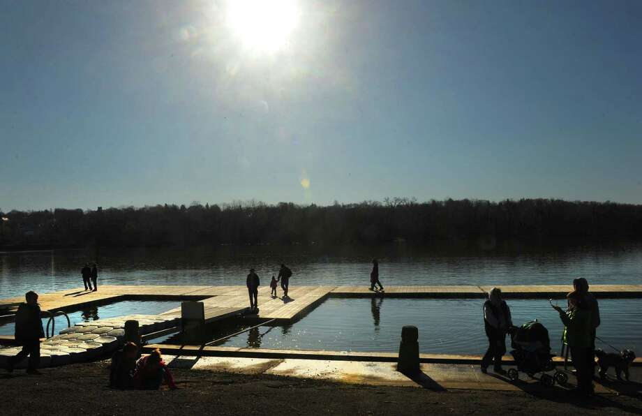 People take advantage of the sunshine and mild weather during the Albany Rowing Center's 3rd annual Ice Breaker Challenge 5K at the Corning Preserve on Saturday March 30, 2013 in Albany, N.Y. (Michael P. Farrell/Times Union) Photo: Michael P. Farrell