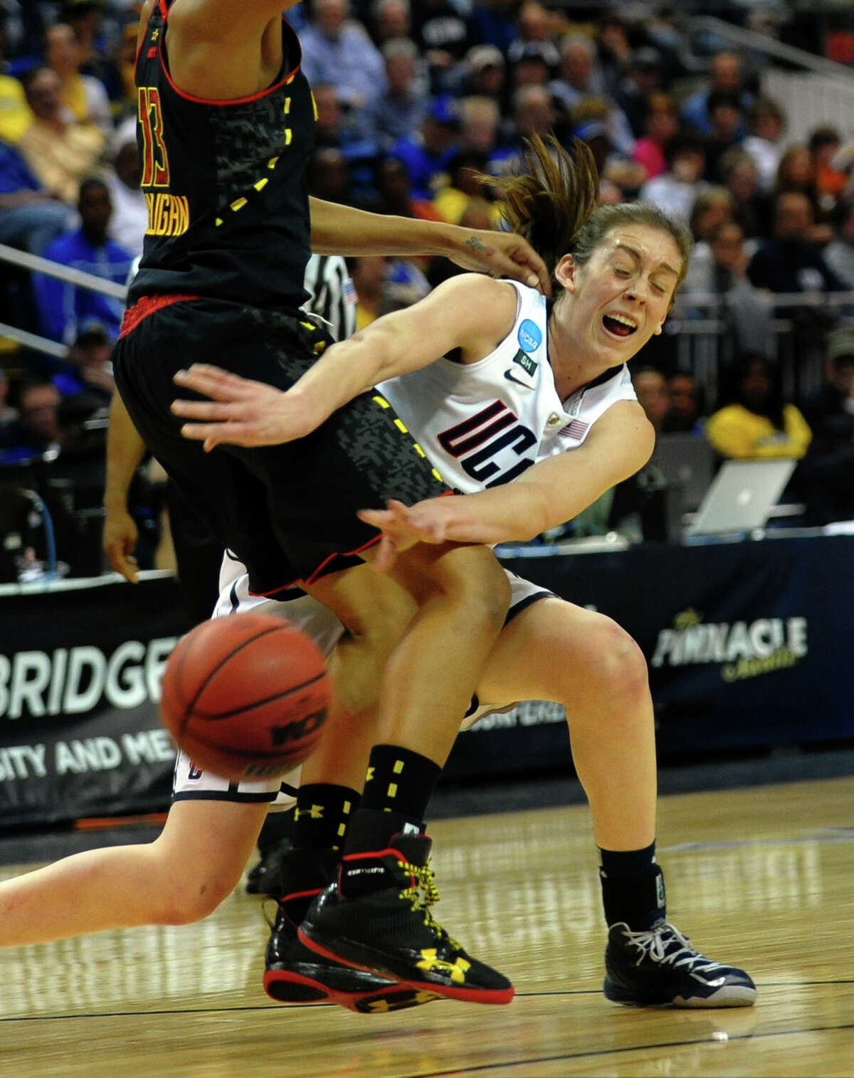 UConn's Breanna Stewart passes the ball around University of Maryland's Alicia DeVaughn, during the women's NCAA Tournament Regional Semifinals at the Webster Bank Arena in Bridgeport, Conn. on Saturday March 30, 2013.