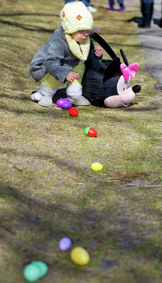 Amelia Bialczak, 1, collects eggs during the 9th Annual Heckscher Farm Egg Hunt on Saturday, March 30, 2013. Photo: Lindsay Perry / Stamford Advocate