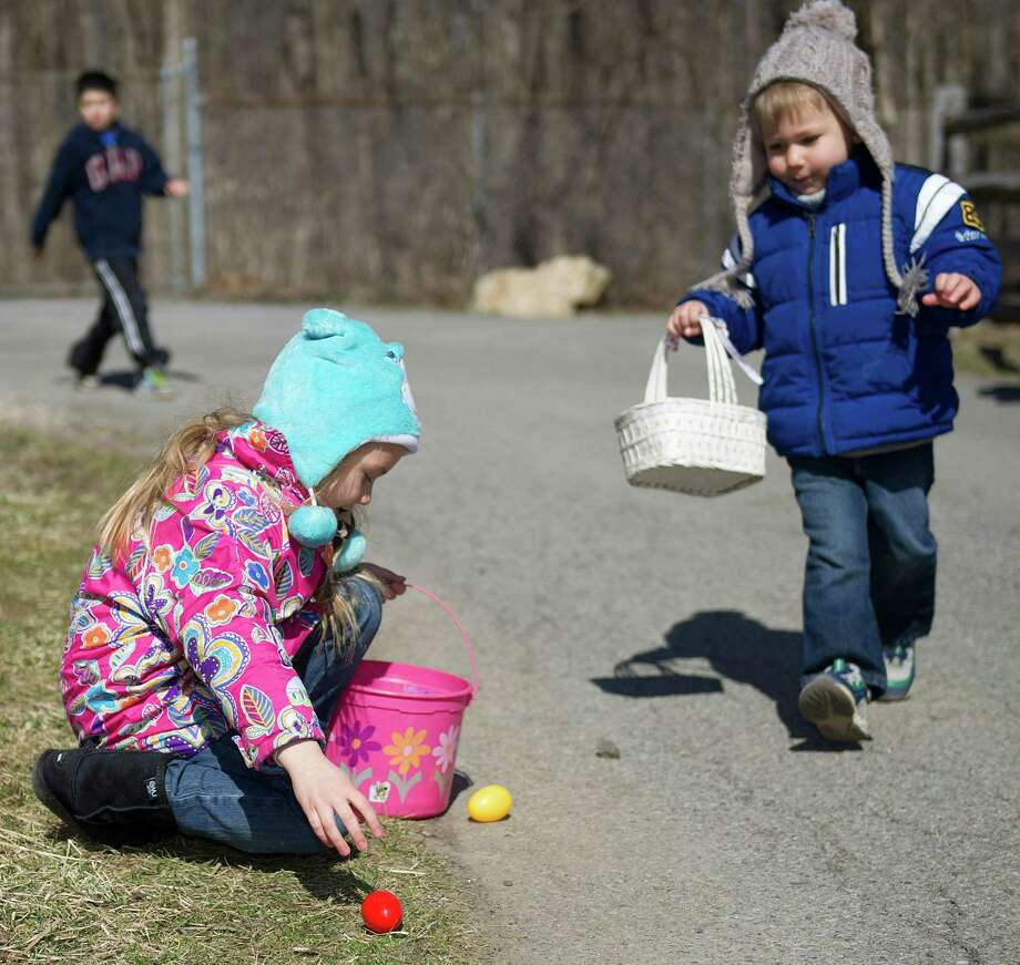 Olivia Cieciwa, 6, collects eggs during the 9th Annual Heckscher Farm Egg Hunt on Saturday, March 30, 2013. Photo: Lindsay Perry / Stamford Advocate