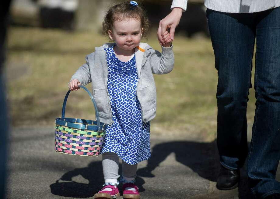 Jessica Orsagh, 1, collects eggs during the 9th Annual Heckscher Farm Egg Hunt on Saturday, March 30, 2013. Photo: Lindsay Perry / Stamford Advocate