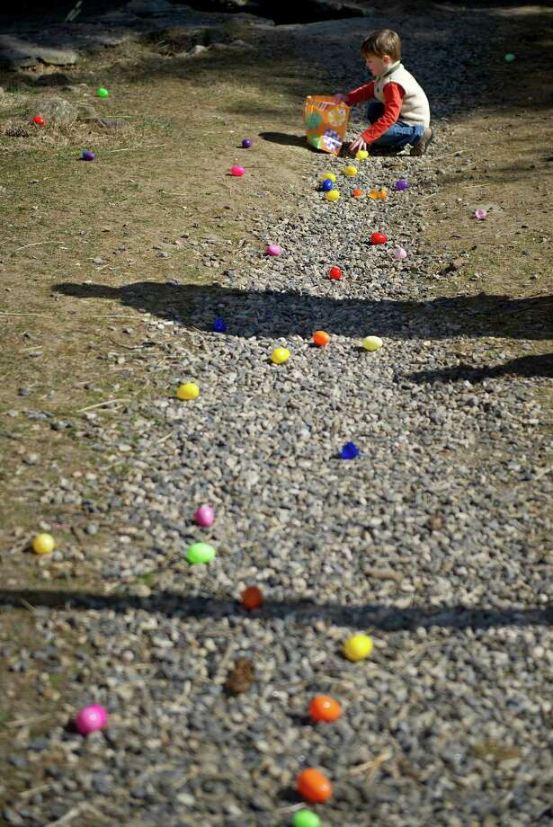 Children collect eggs during the 9th Annual Heckscher Farm Egg Hunt on Saturday, March 30, 2013. Photo: Lindsay Perry / Stamford Advocate
