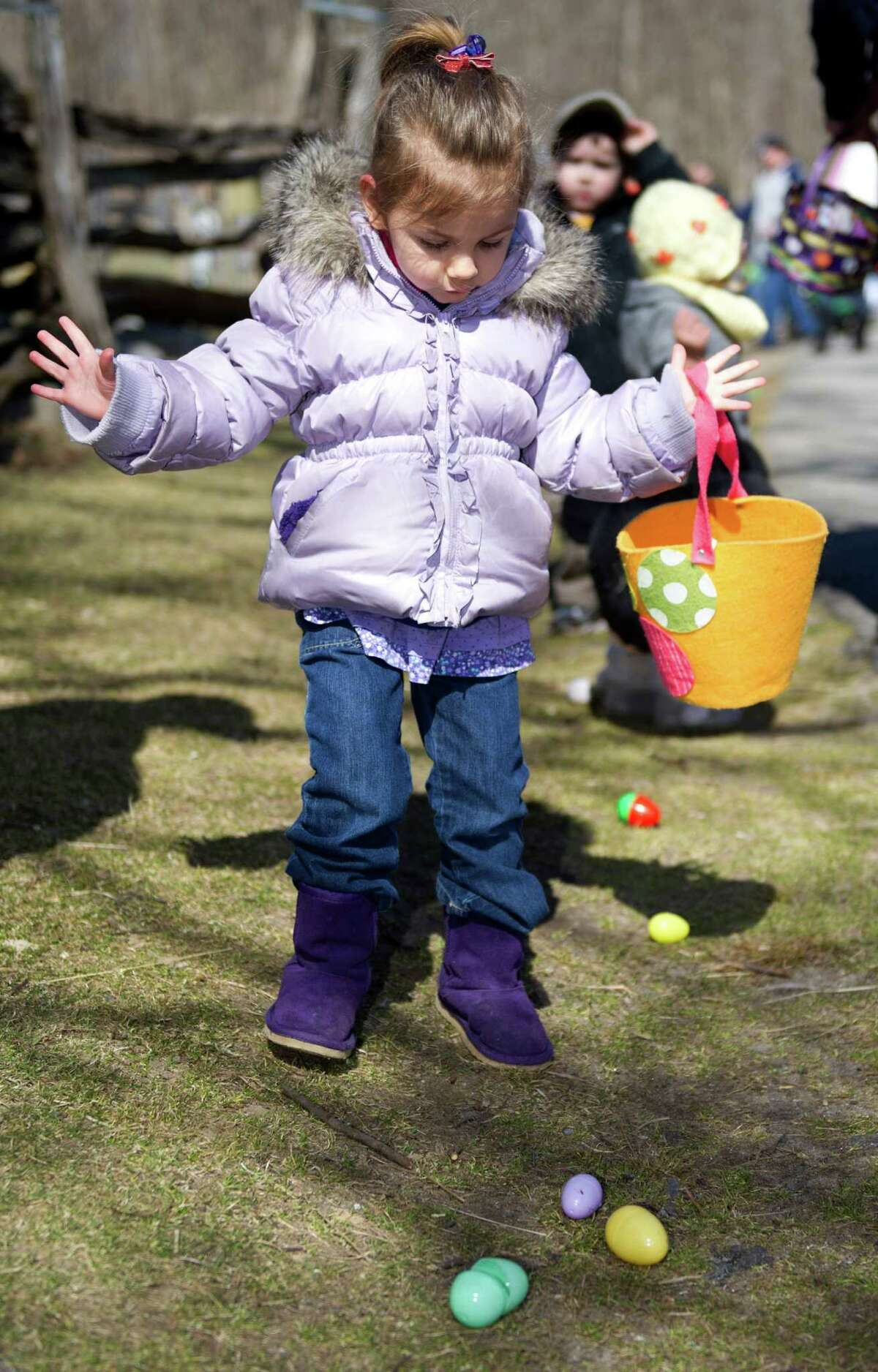 Children collect eggs during the 9th Annual Heckscher Farm Egg Hunt on Saturday, March 30, 2013.