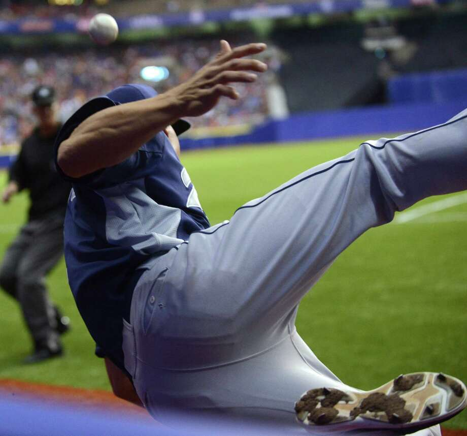 San Diego Padres third baseman Cody Ransom is unable to catch a foul pop fly near the photographer's well in the Alamodome during Big League Weekend exhibition baseball action on Saturday, March 30, 2013. Photo: Billy Calzada, San Antonio Express-News / San Antonio Express-News