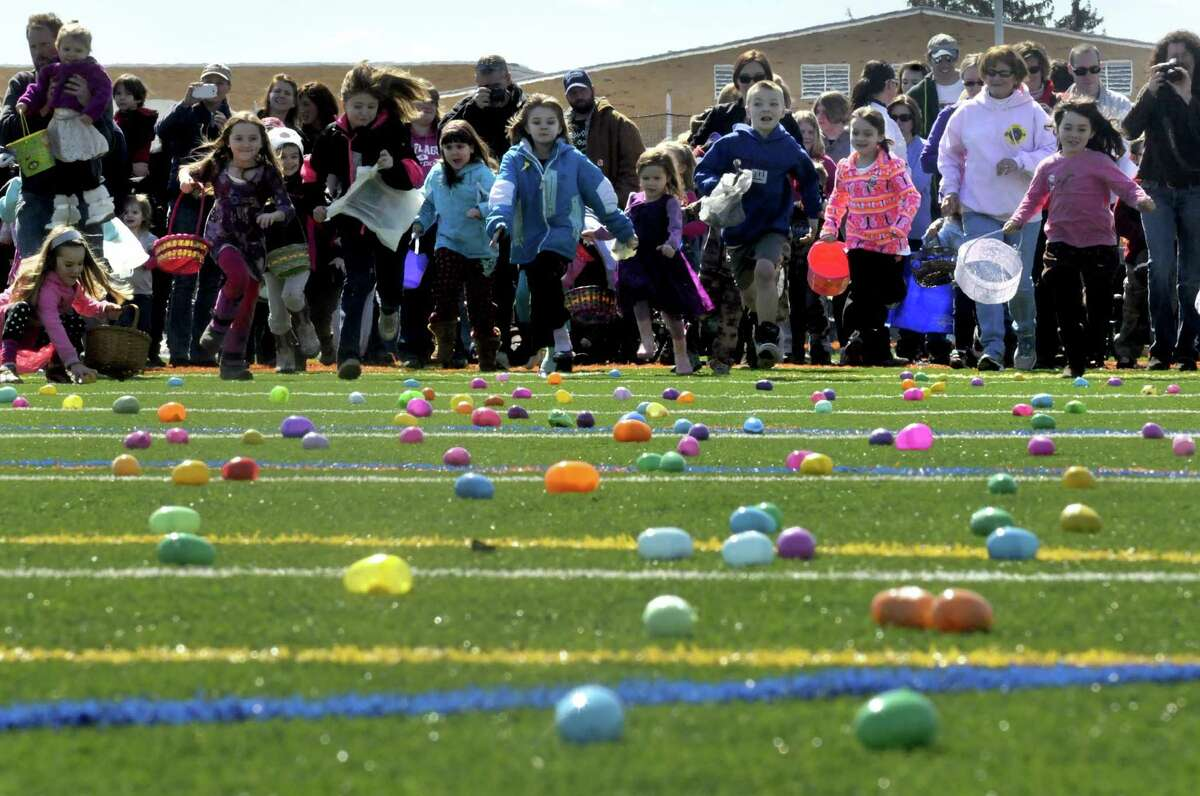 Children a parents break from the start during the 5th Annual Great Schuylerville Egg Hunt on Saturday March 30, 2013 in Schuylerville, N.Y. (Michael P. Farrell/Times Union)