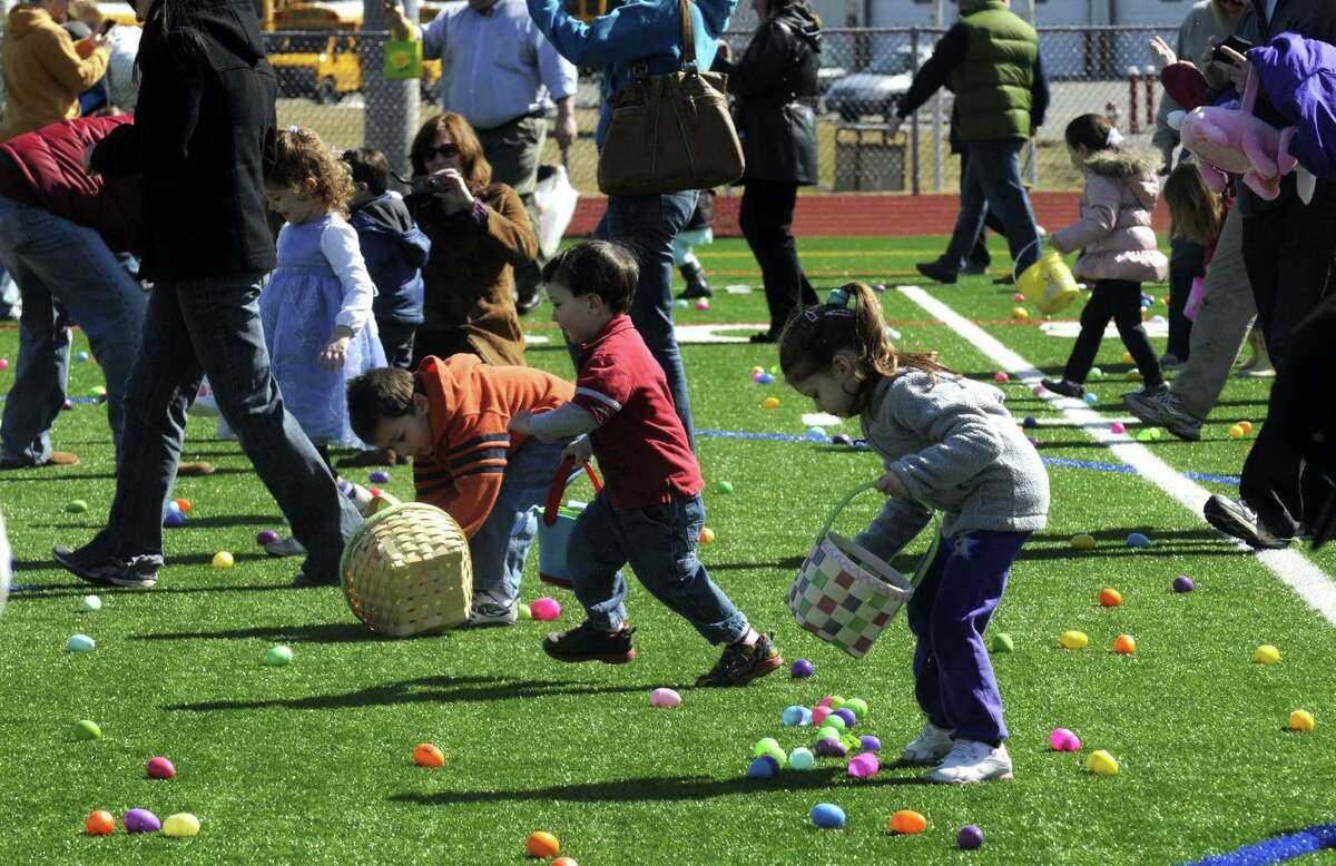 Children gather candy filled eggs during the 5th Annual Great Schuylerville Egg Hunt on Saturday March 30, 2013 in Schuylerville, N.Y. (Michael P. Farrell/Times Union)