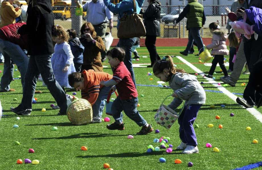 Children gather candy filled eggs during the 5th Annual Great Schuylerville Egg Hunt on Saturday March 30, 2013 in Schuylerville, N.Y. (Michael P. Farrell/Times Union) Photo: Michael P. Farrell