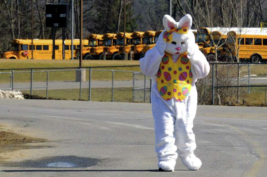 The Easter bunny makes some adjustments before greeting children during the 5th Annual Great Schuylerville Egg Hunt on Saturday March 30, 2013 in Schuylerville, N.Y. (Michael P. Farrell/Times Union) Photo: Michael P. Farrell