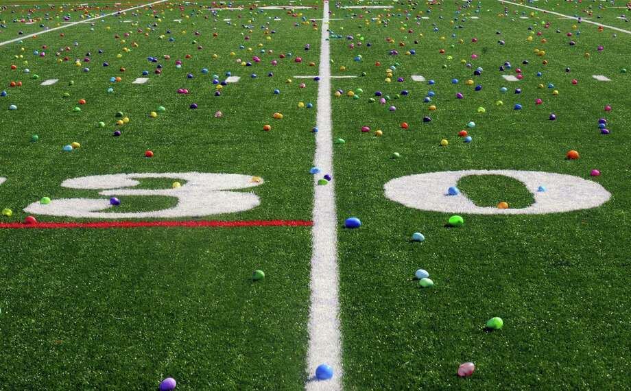 The Schuylerville High School football field is awash in candy-filled eggs during the 5th Annual Great Schuylerville Egg Hunt on Saturday March 30, 2013 in Schuylerville, N.Y. (Michael P. Farrell/Times Union) Photo: Michael P. Farrell
