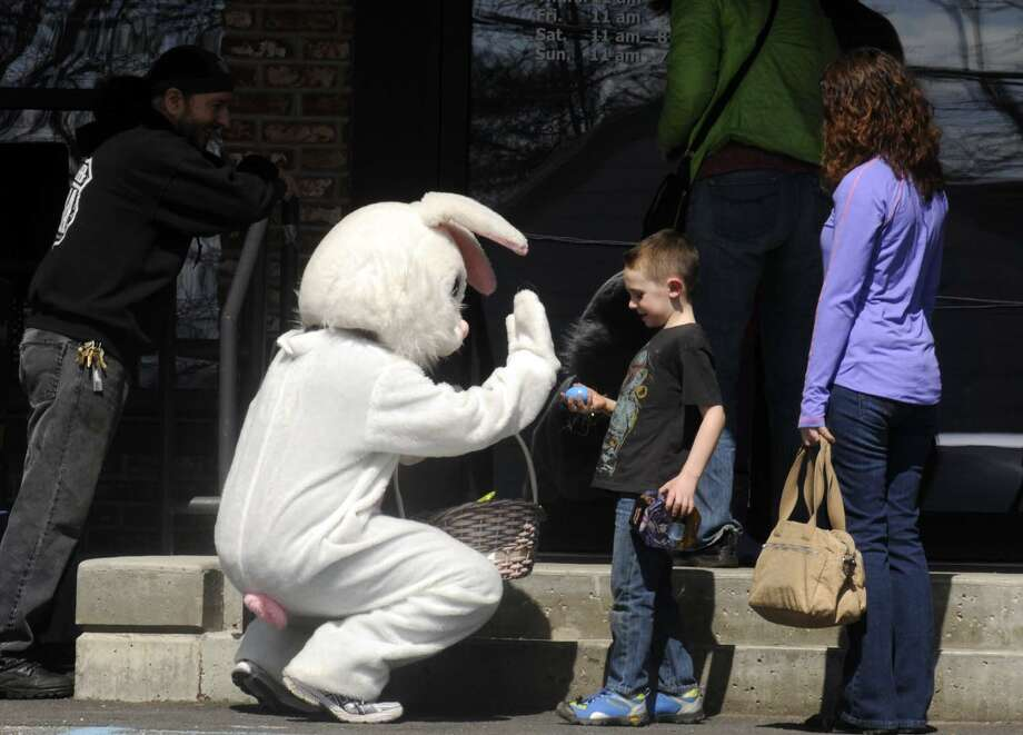 The Easter bunny visits with patrons at PJ's Bar-B-QSA on Saturday March 30, 2013 in Saratoga Springs, N.Y. (Michael P. Farrell/Times Union) Photo: Michael P. Farrell