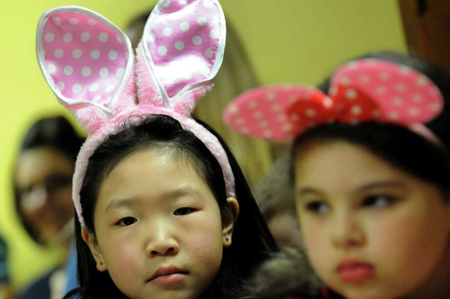 Coey Ni, 6, left, and her friend Hannah Yacout, 6, both of Watervliet, wear Easter appropriate head wear as they attend an Easter party on Saturday, March 30, 2013, at the Watervliet Senior Citizens Center in Watervliet, N.Y. (Cindy Schultz / Times Union) Photo: Cindy Schultz / 00021629A