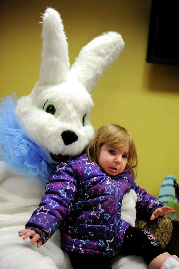 Annabella Garcia Corona, 2, of Watervliet shows uncertainty when she sits on the Easter Bunny's lap for a picture during an Easter party on Saturday, March 30, 2013, at the Watervliet Senior Citizens Center in Watervliet, N.Y. (Cindy Schultz / Times Union) Photo: Cindy Schultz / 00021629A
