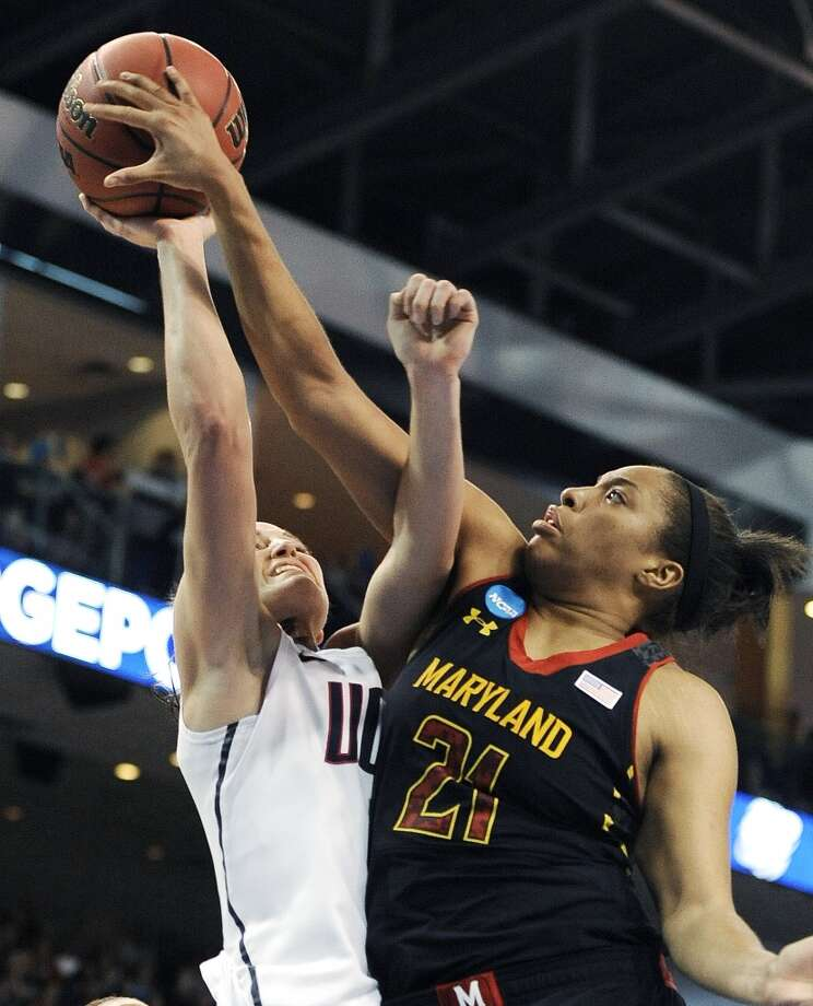 Maryland's Tianna Hawkins (21) stops a shot attempt by Connecticut's Kelly Faris during the first half of a regional semifinal in the NCAA college basketball tournament in Bridgeport, Conn., Saturday, March 30, 2013. (AP Photo/Jessica Hill)