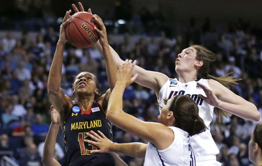 Connecticut forward Breanna Stewart, right, tries to block a shot by Maryland center Alicia DeVaughn (13) during the first half of an NCAA women's college regional semifinal basketball game in Bridgeport, Conn., Saturday, March 30, 2013. At bottom right is Connecticut center Stefanie Dolson. (AP Photo/Charles Krupa)