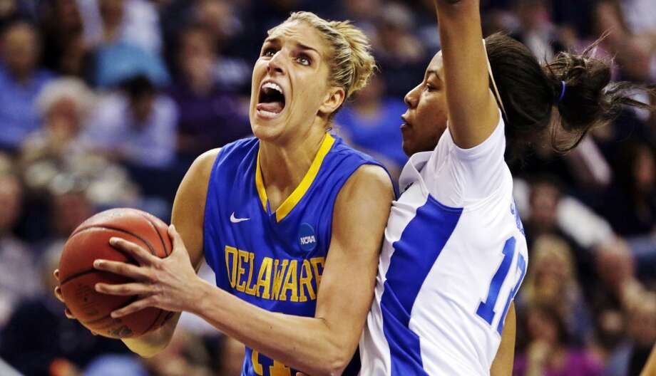 Delaware forward Elena Delle Donne, left, drive to the basket against Kentucky forward Jelleah Sidney, right, during the second half of a regional semifinal in the NCAA college basketball tournament in Bridgeport, Conn., Saturday, March 30, 2013. Delle Donne scored 33 points, but Kentucky won 69-62. (AP Photo/Charles Krupa)