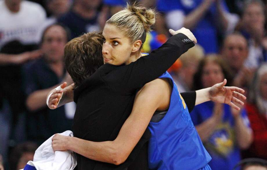 Delaware forward Elena Delle Donne, right, is embraced by head coach Tina Martin as she is taken out of the game with 10 second remaining during the second half of an NCAA women's college regional semifinal basketball game against Kentucky in Bridgeport, Conn., Saturday, March 30, 2013. Donne had 33 points in the 69-62 loss to Kentucky. (AP Photo/Charles Krupa)
