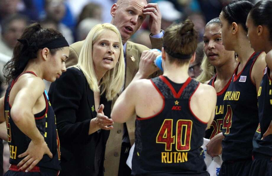 Maryland head coach Brenda Frese, center left, talks with her players during the first half of an NCAA women's college regional semifinal basketball game against Connecticut in Bridgeport, Conn., Saturday, March 30, 2013. (AP Photo/Charles Krupa)