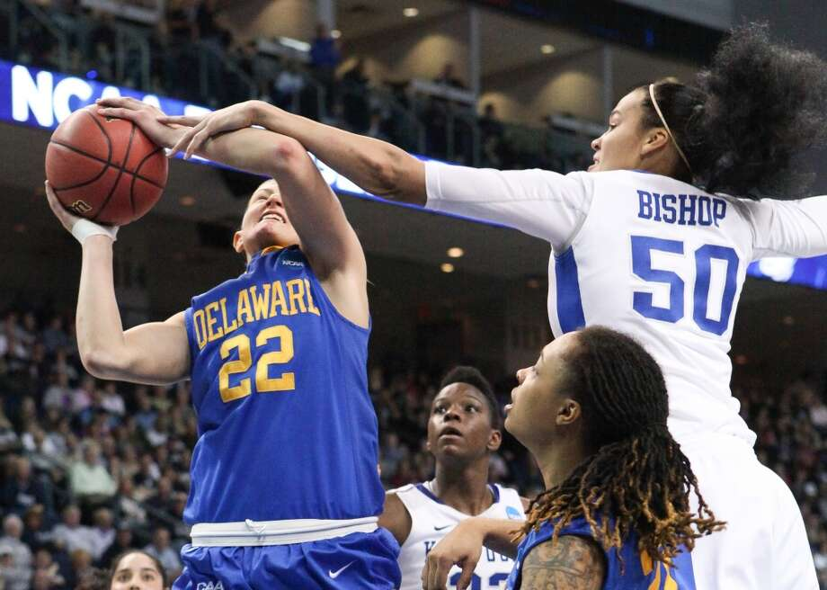 Kentucky's Azia Bishop (50) fouls Delaware guard Lauren Carra during an NCAA women's college regional semifinal basketball game in Bridgeport, Conn., Saturday, March 30, 2013. Kentucky won 69-62. (AP Photo/The Wilmington News-Journal, Suchat Pederson) NO SALES.