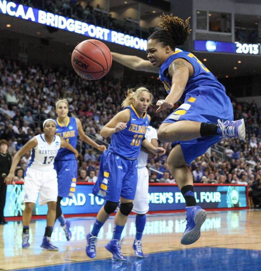 Delaware guard Trumae Lucas tries to get the rebound against Kentucky during an NCAA women's college regional semifinal basketball game in Bridgeport, Conn., Saturday, March 30, 2013. Kentucky won 69-62. (AP Photo/The Wilmington News-Journal, Suchat Pederson) NO SALES.