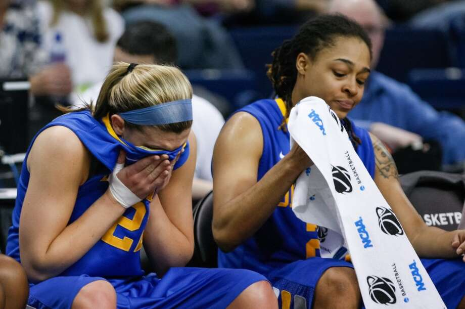 Delaware guard Lauren Carra, left, covers her face next to guard Trumae Lucas as the Blue Hens season comes to an end losing to Kentucky 69-62 during an NCAA women's college regional semifinal basketball game in Bridgeport, Conn., Saturday, March 30, 2013. (AP Photo/The Wilmington News-Journal, Suchat Pederson) NO SALES.