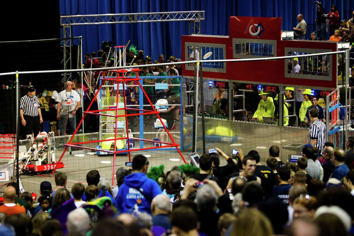 Hundreds of onlookers - both parents and students - enjoy the qualifying rounds of the FIRST Robotics Competition at the CenturyLink Field Event Center in Seattle on Saturday, March 30, 2013. Sixty-four high school students competed - robot against robot - in a challenge that test their technological creation's ability to throw Frisbees into goals.