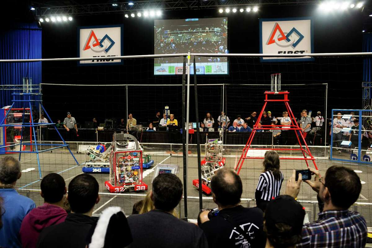 Hundreds of onlookers - both parents and students - enjoy the qualifying rounds of the FIRST Robotics Competition.