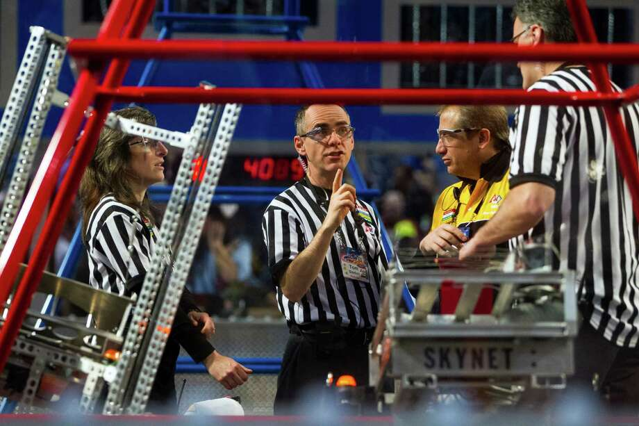 Refs deliberate before a robot bout during the qualifying rounds. Photo: JORDAN STEAD / SEATTLEPI.COM