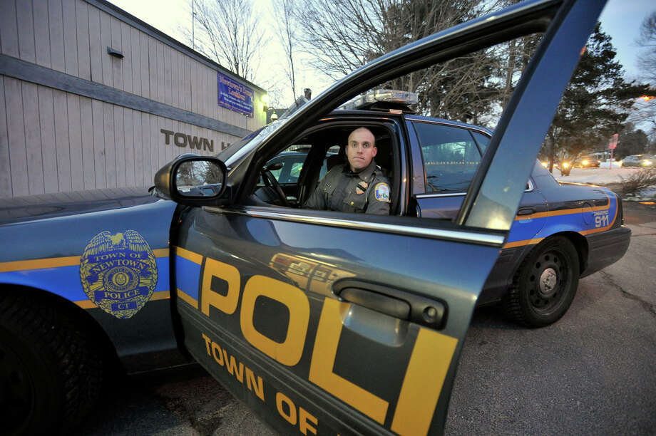 Newtown police officer William Chapman was one of the first responders to the Sandy Hook Elementary School shooting. He is photographed outside the Newtown Police Department on Friday, Dec. 28, 2012. Photo: Jason Rearick / The News-Times