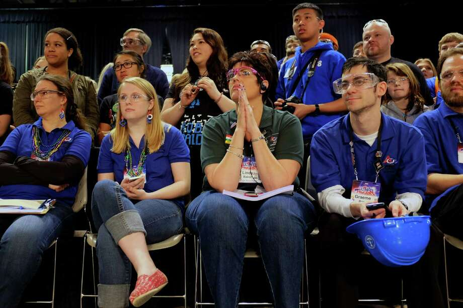 Attendees wait anxiously for results during the qualifying rounds. Photo: JORDAN STEAD / SEATTLEPI.COM